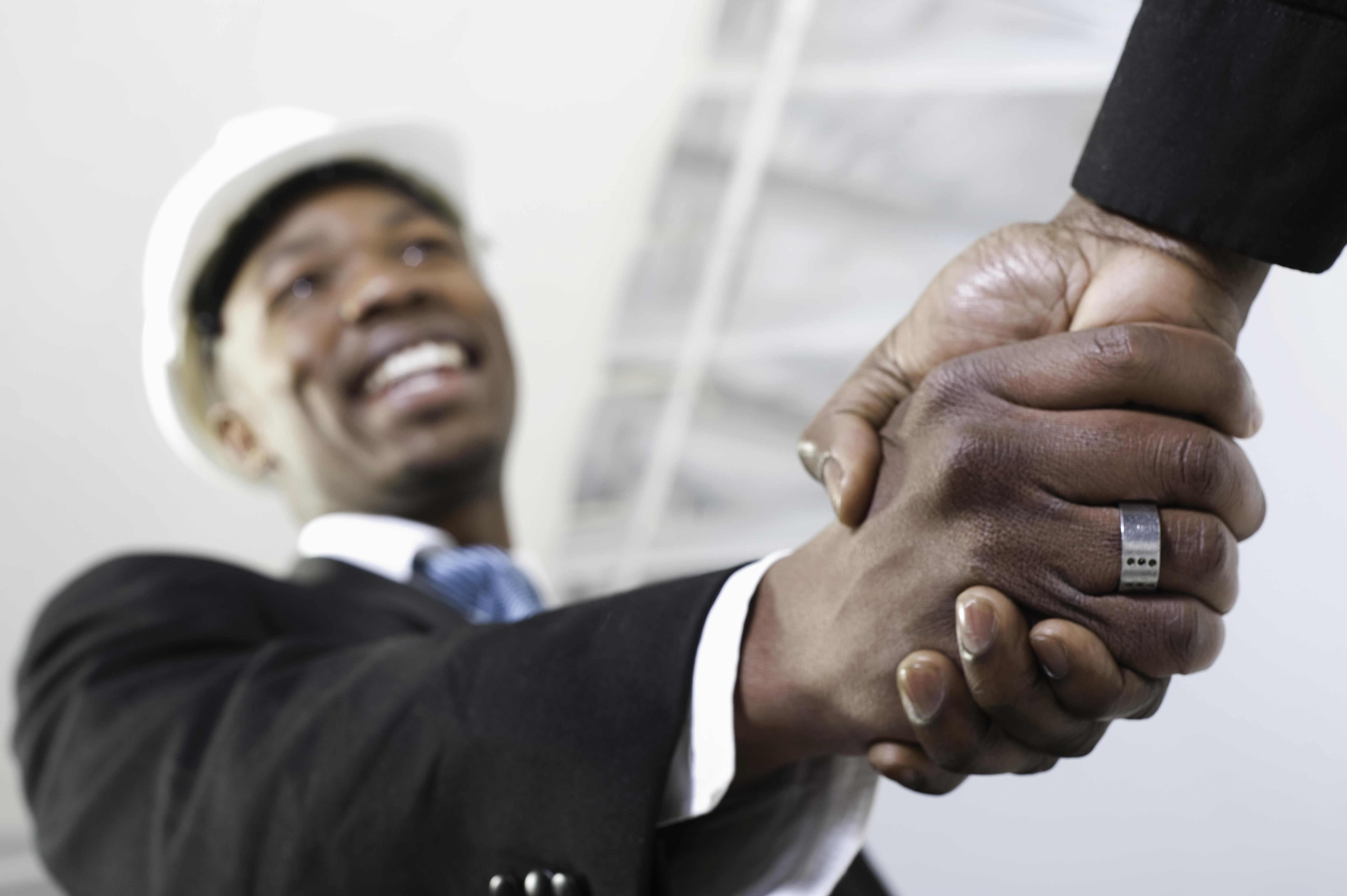 Low angle view of a building contractor shaking hands, South Africa