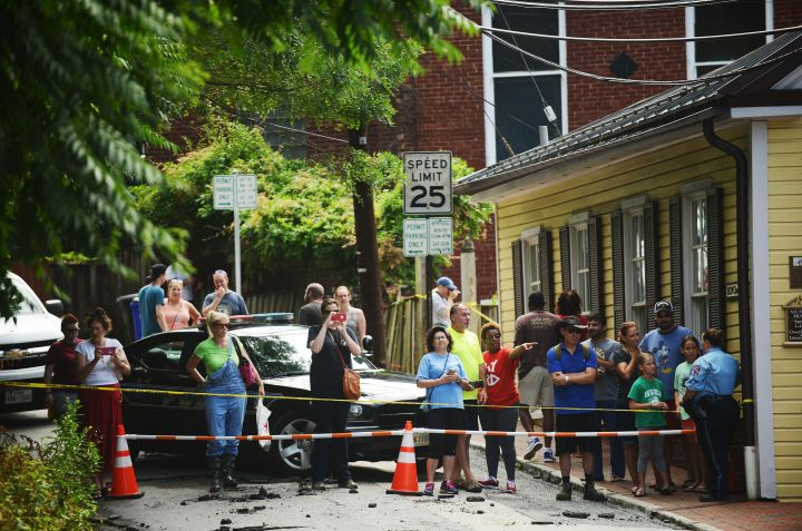 ELLICOTT CITY, MD - JULY 31: Bystanders watch rescue workers a