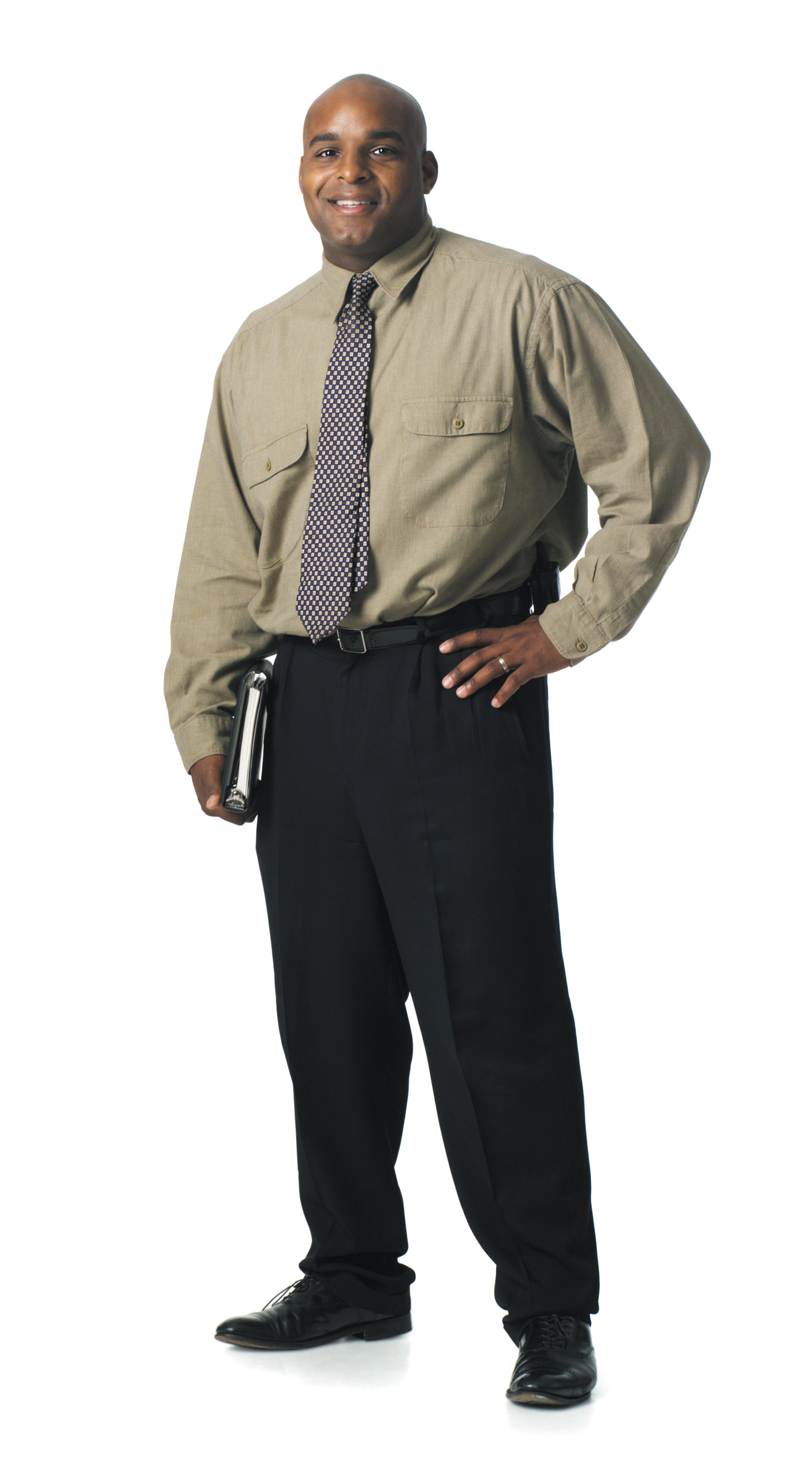 a young african american business man in a shirt and a tie smiles at the camera