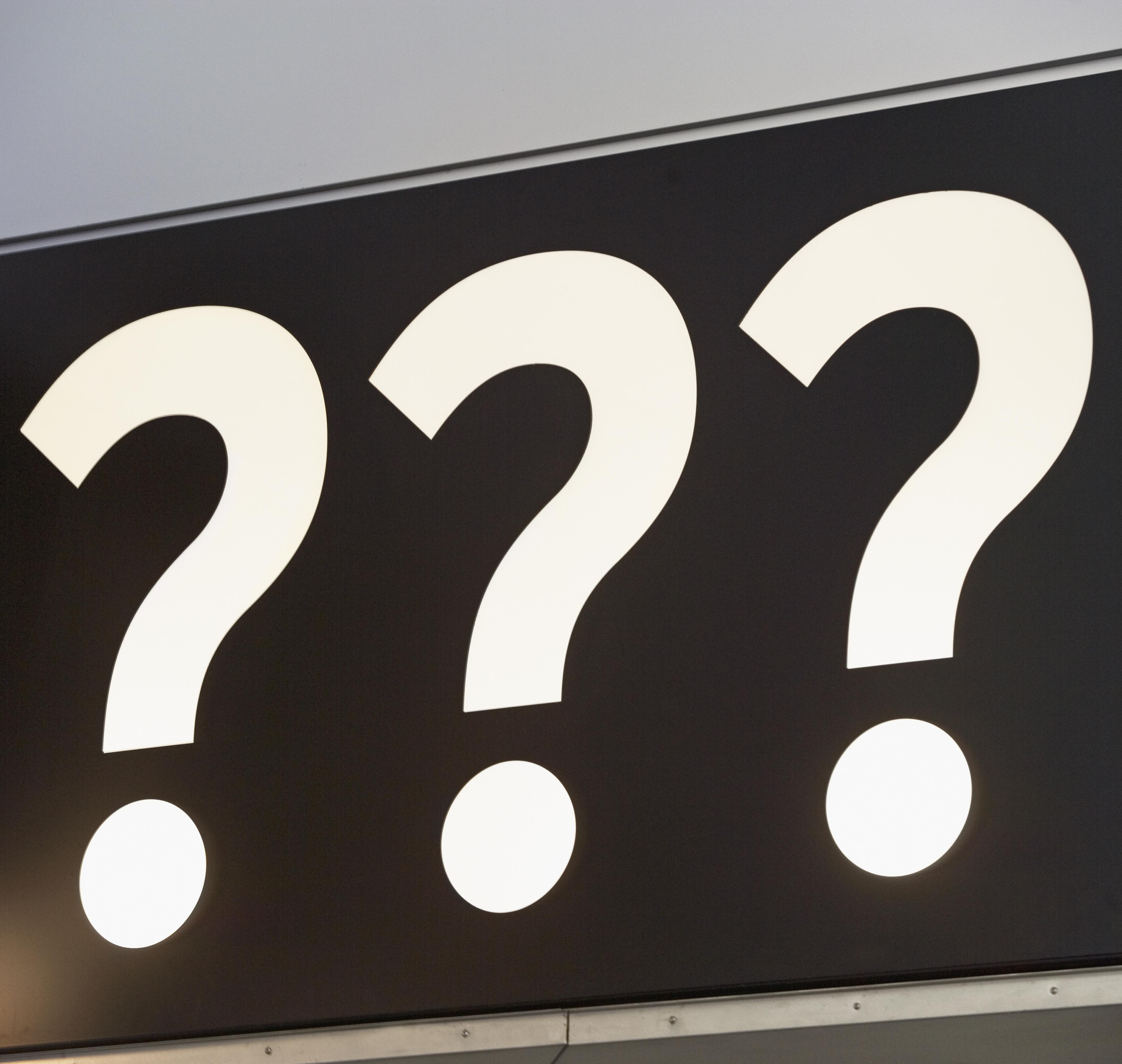 Question marks on sign