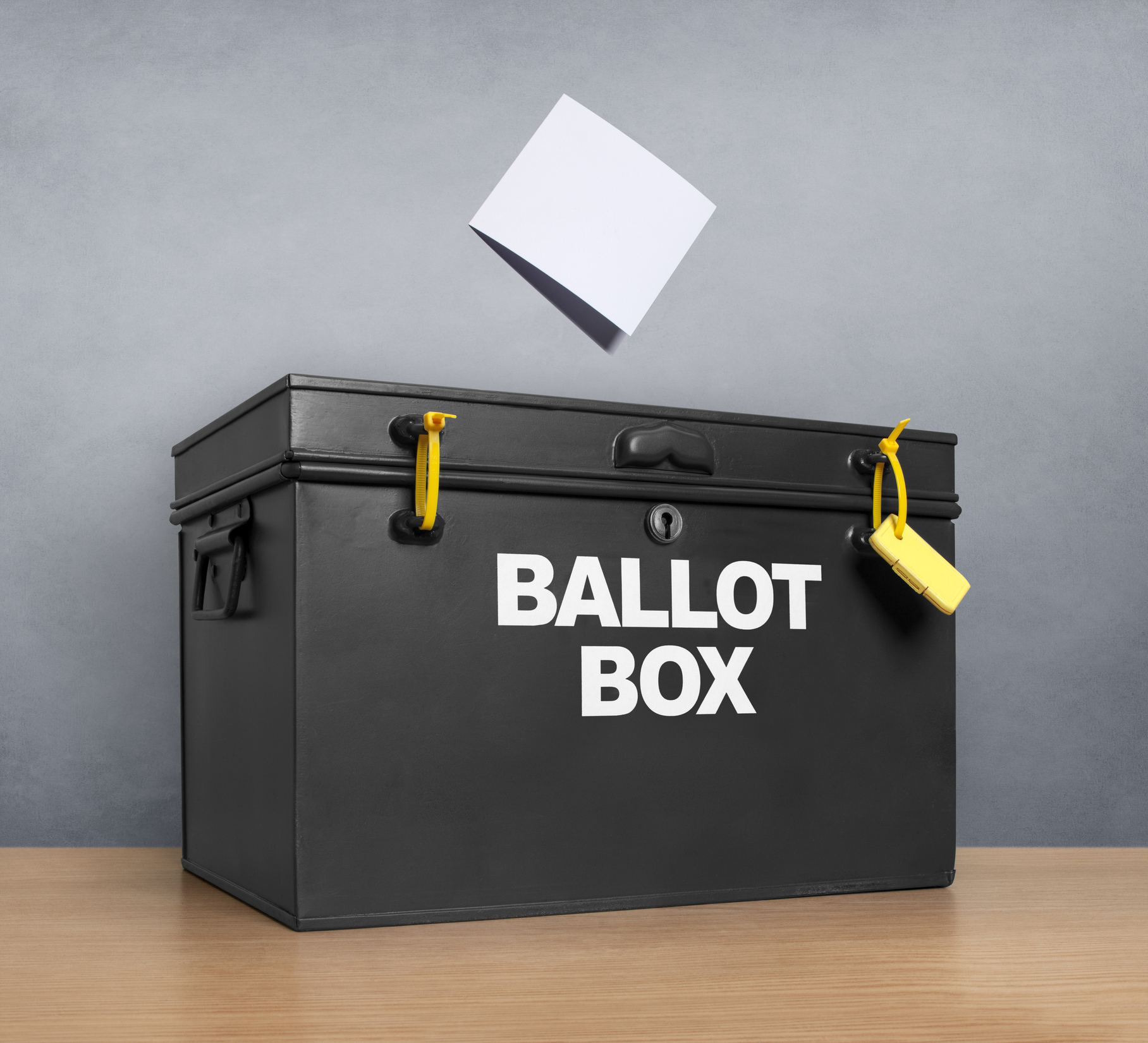 Ballot paper poised above the ballot box