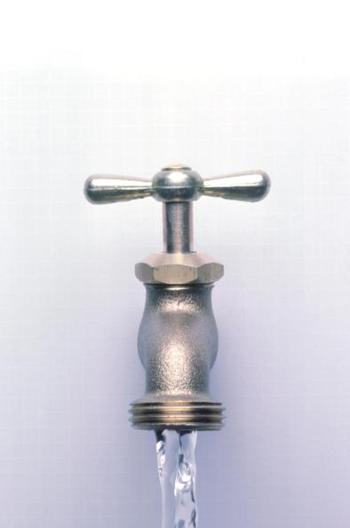 water coming out of a faucet