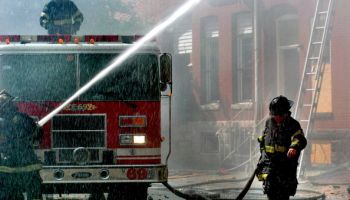 Baltimore City firefighters battle a blaze that engulfed muc