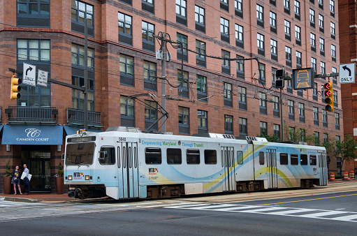 MTA Light Rail public transportation train in the streets of Baltimore