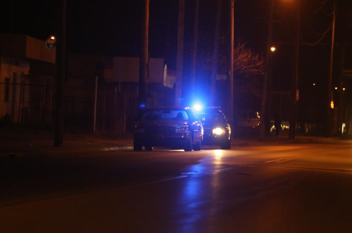 Police vehicle stop a speeding motorist on a dark road