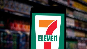In this photo illustration the 7-Eleven logo seen displayed...