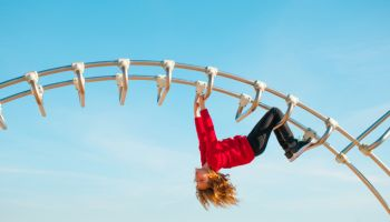Girl Playing on a Climbing Frame