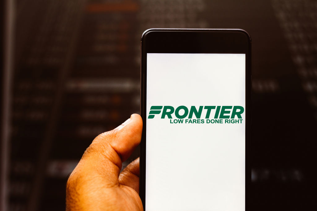 In this photo illustration the Frontier Airlines logo is...