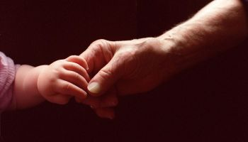 Generic baby holding an elderly persons hand, 1 November 2000. AFR Picture by