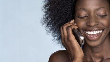 Woman using Cellular Telephone