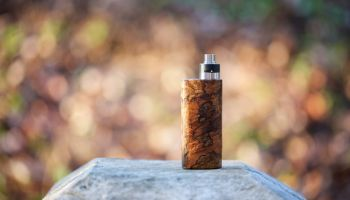 Close-Up Of Electronic Cigarette On Rock