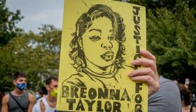 A participant holding a Justice For Breonna Taylor sign at...